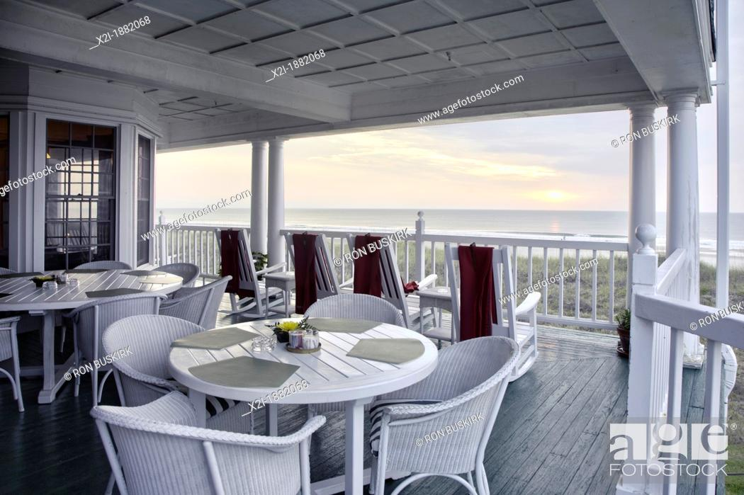 Stock Photo: Scenic view of sunrise over the Atlantic Ocean from porch of Elizabeth Pointe Lodge at Amelia Island, Florida.