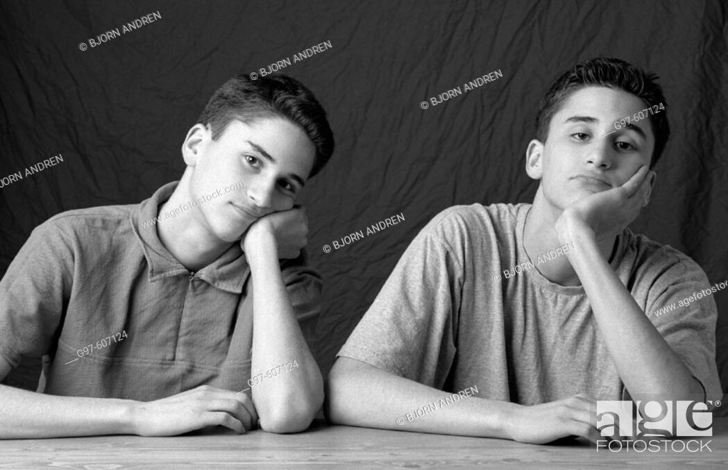 Stock Photo: Twin brothers at table.