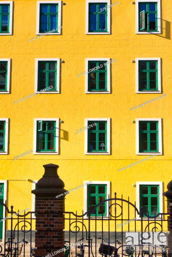 Stock Photo: Yellow painted house in bright sunlight, Christianshavn, Copenhagen, Denmark, Scandinavia.