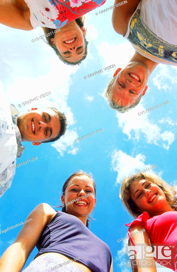 Stock Photo: Portrait of a group of young people smiling.