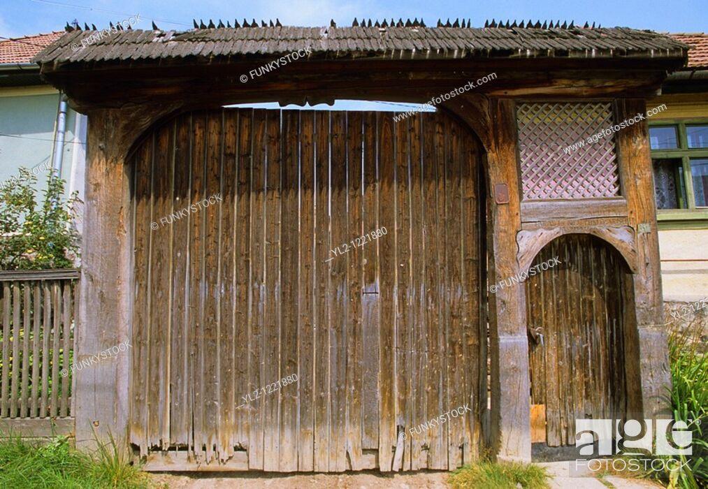 Stock Photo: Ornamental painted carved wood Szekely village farm gate  Transylvania, Romania.