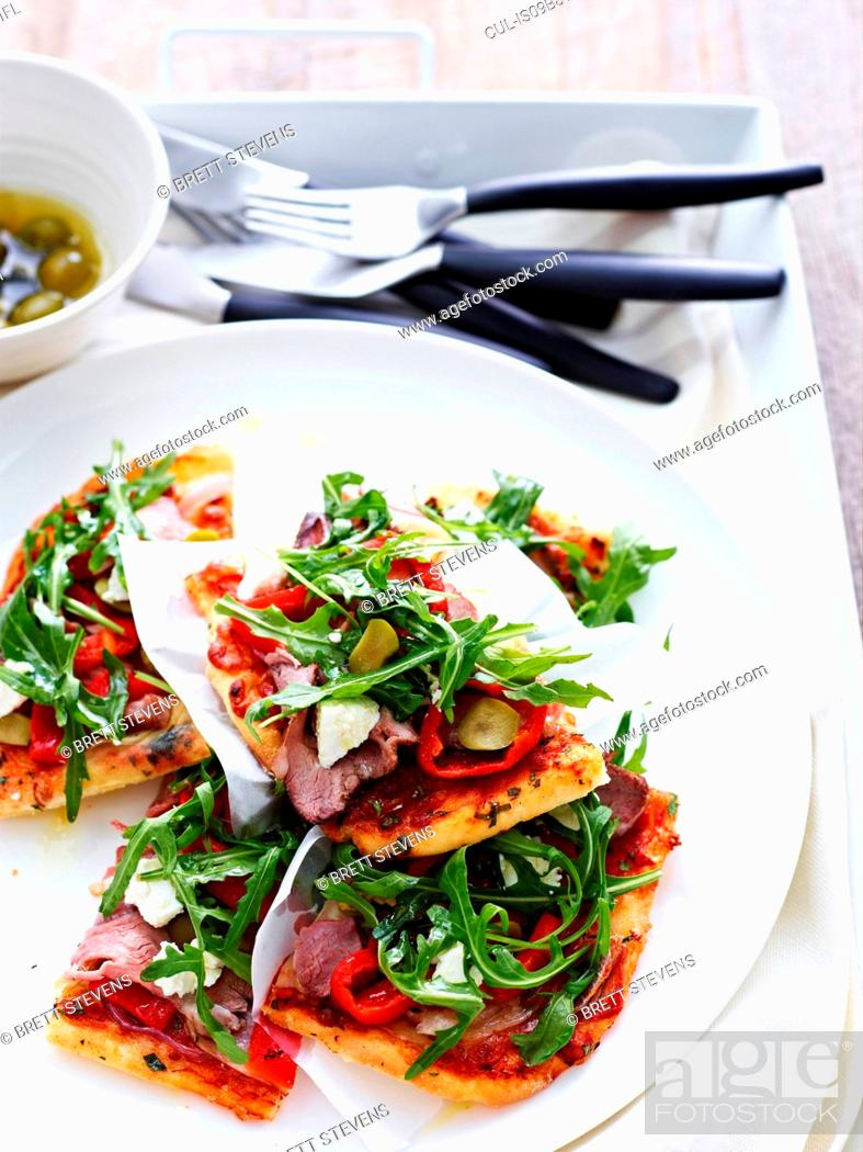 Stock Photo: Sliced, roast lamb and potato pizza on white plate.