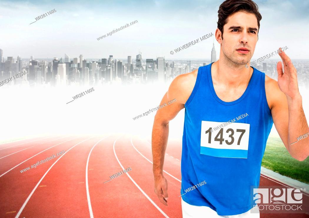Stock Photo: Male runner sprinting on track against blurry skyline.