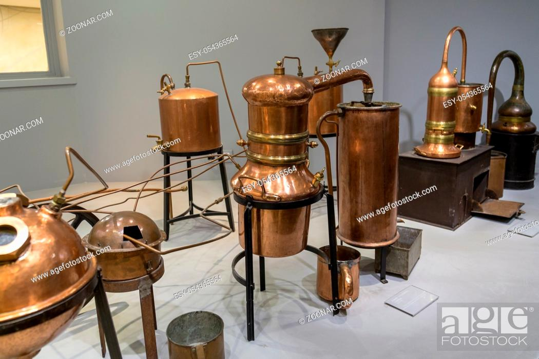 Stock Photo: distiller for the production of perfume water, the copper metal vat, a museum piece.