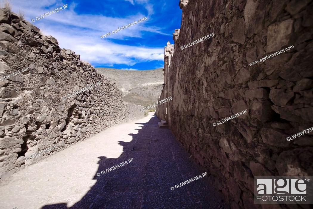 Stock Photo: Stone wall along a street, Real De Catorce, San Luis Potosi, Mexico.