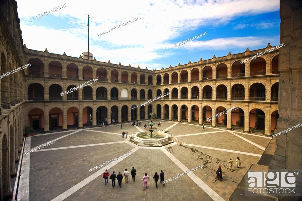 Stock Photo: High angle view of tourists in the courtyard of a palace, National Palace, Zocalo, Mexico City, Mexico.