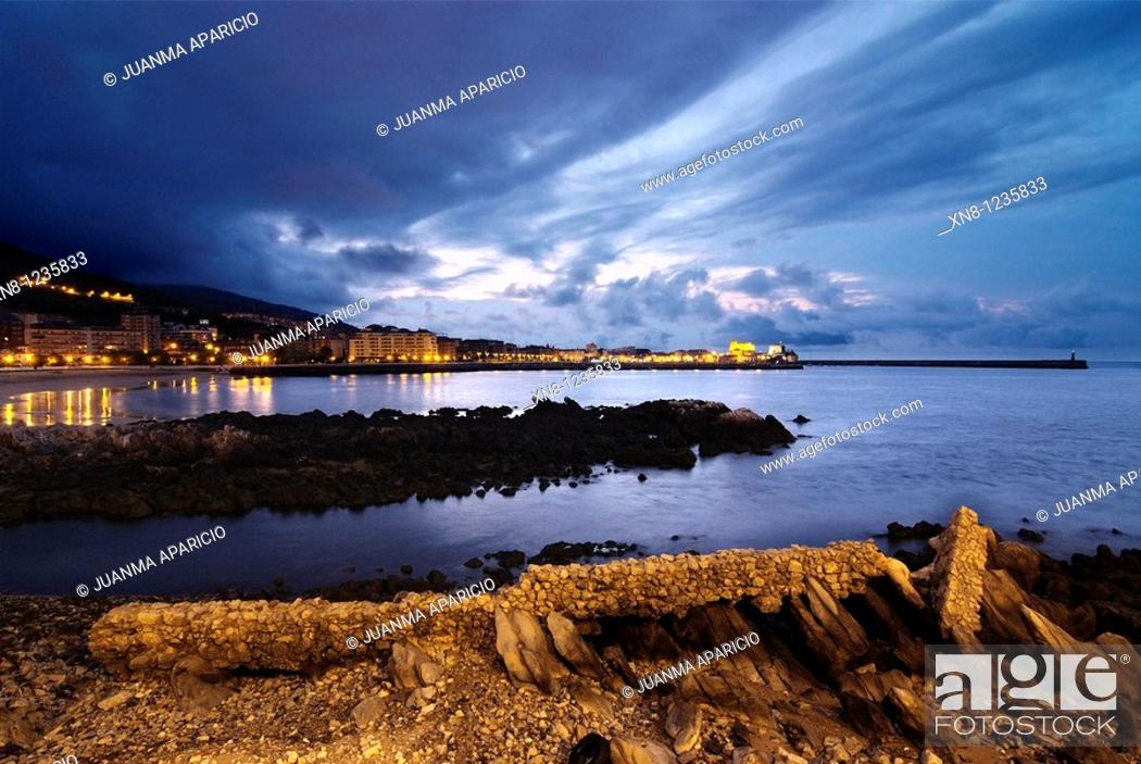 Stock Photo: Night shots of Castro Urdiales, Spain, from Cotolino with Plimer stone remains of an ancient shipyard plan.