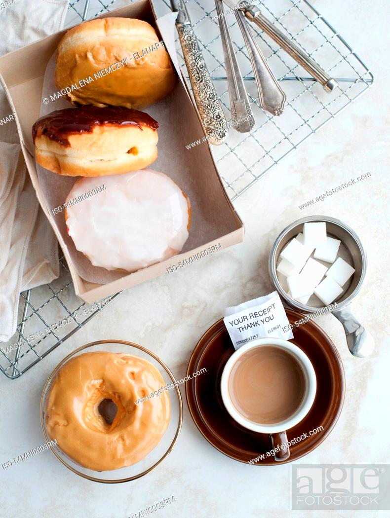 Stock Photo: Cup of coffee with donuts and sugar.