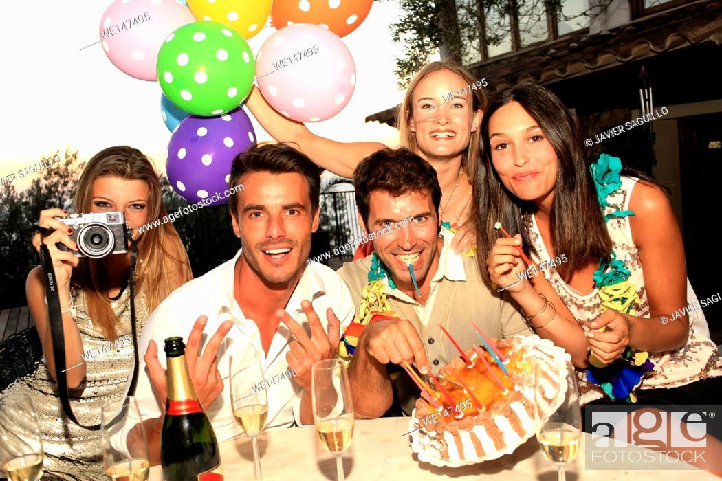 Stock Photo: Friends enjoying birthday party.