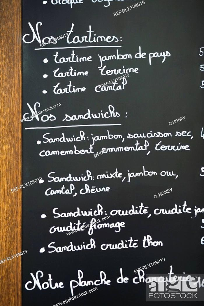 Stock Photo: Close up of blackboard menu outside cafe, Paris France.