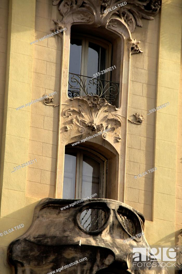 Stock Photo: Modernist building detail, close-up of a balcony and two windows. Carrer del Bruc, Barcelona, Catalonia, Spain.