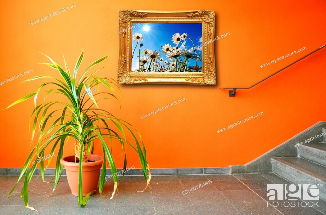 Stock Photo: picture on a wall and plant.