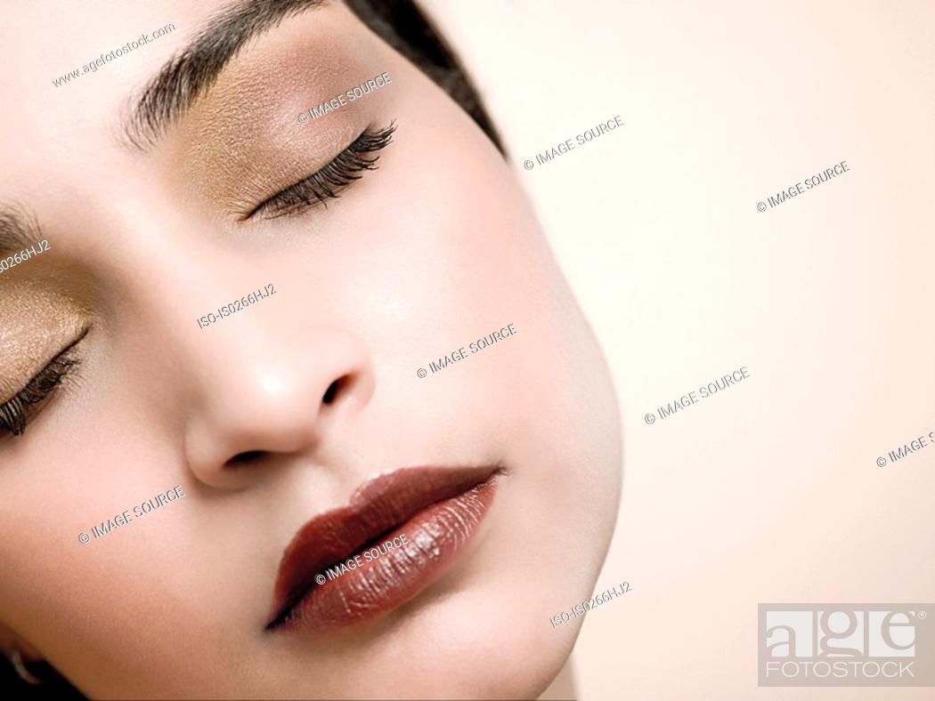 Stock Photo: A young woman sleeping.