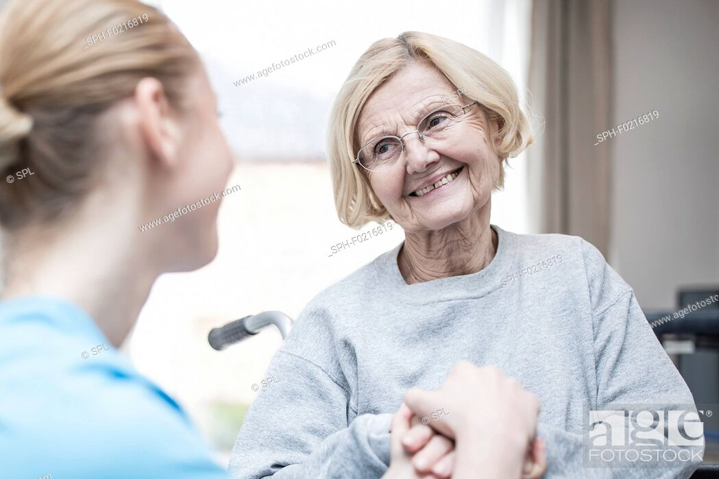 Stock Photo: Woman smiling at carer.