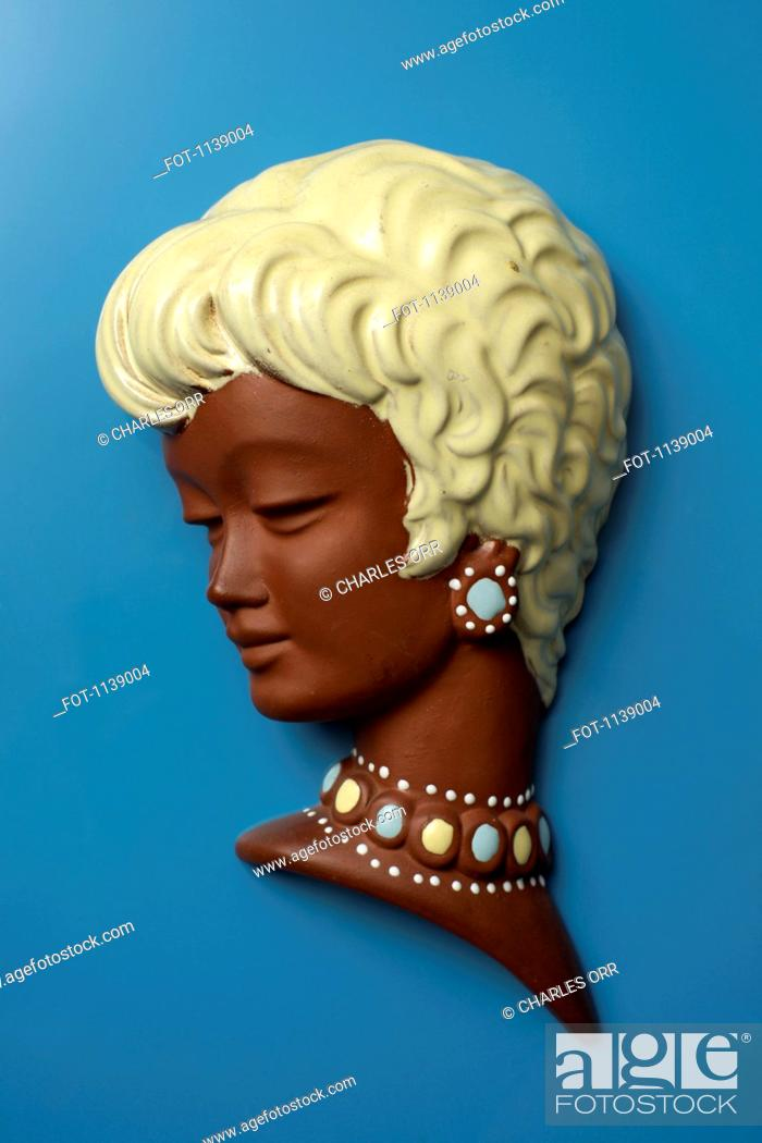 Stock Photo: A retro wall hanging of a woman with short blond hair.