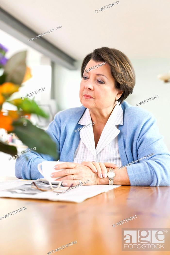 Stock Photo: Germany, Leipzig, Senior woman reading newspaper.