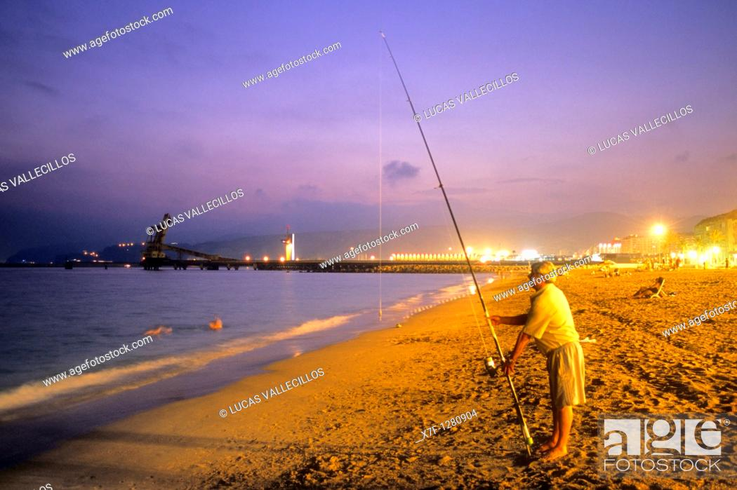 Stock Photo: Fisherman in `Ciudad Luminosa'beach  Almeria  Andalucia, Spain.