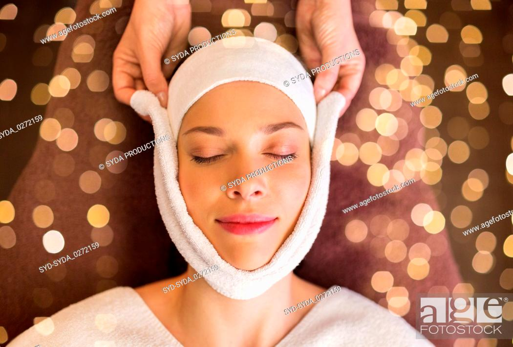 Stock Photo: woman having face massage with towel at spa.