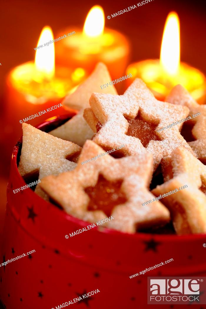 Stock Photo: Close up of Christmas cookies and candles.
