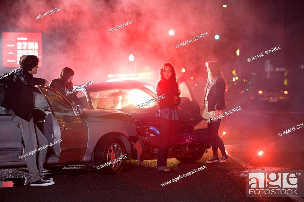 Stock Photo: Young people involved in car crash.
