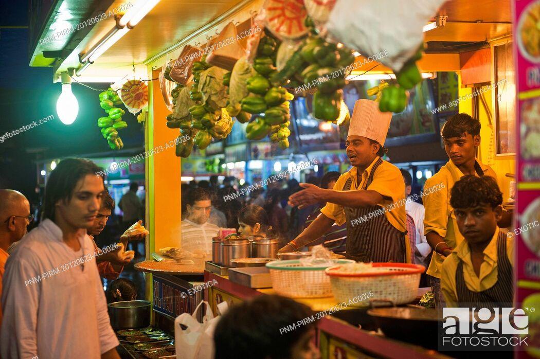 Stock Photo: People at a food stall, Juhu Beach, Mumbai, Maharashtra, India.