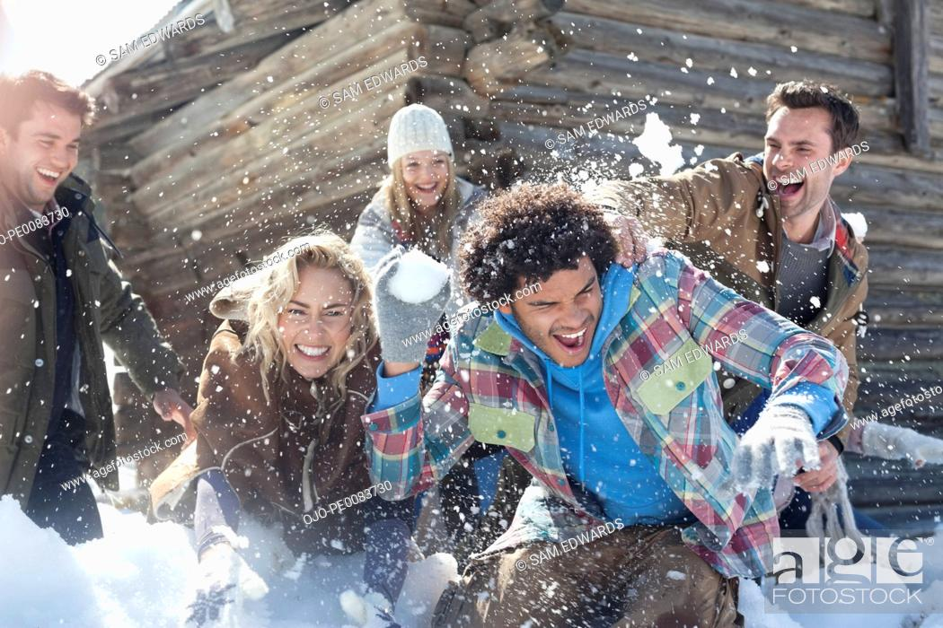 Stock Photo: Friends enjoying snowball fight.