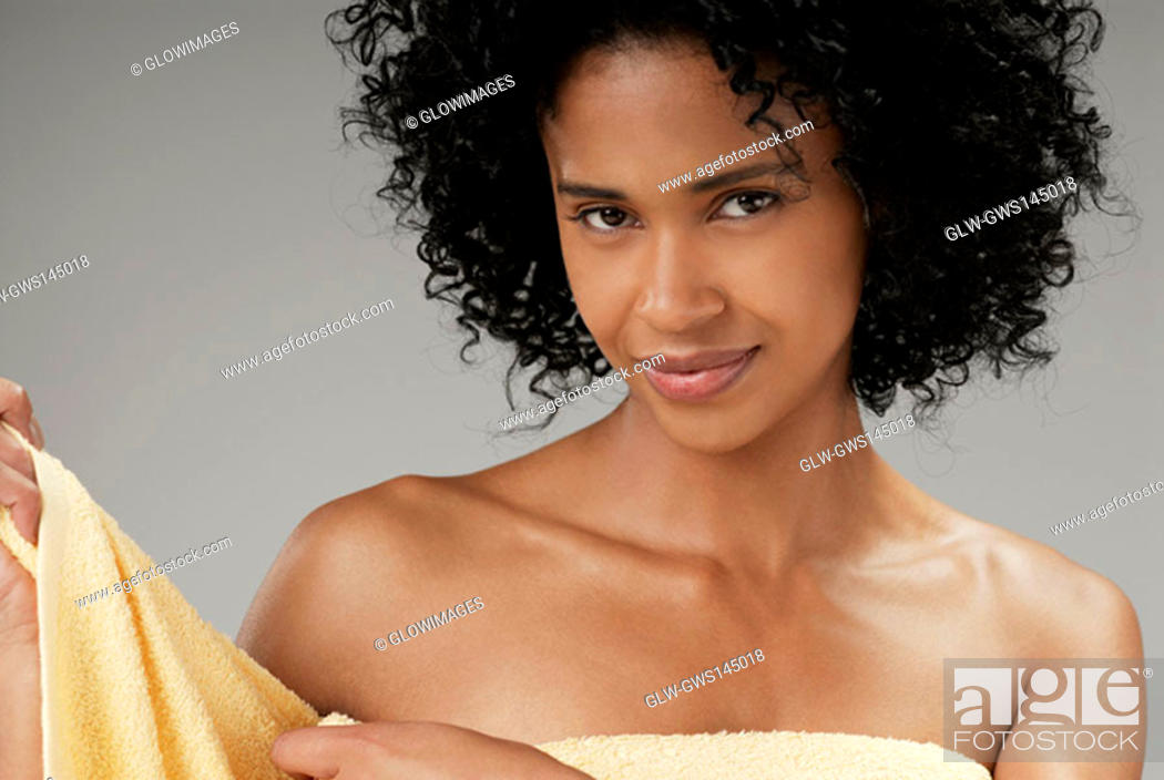Stock Photo: Portrait of a young woman adjusting a towel.