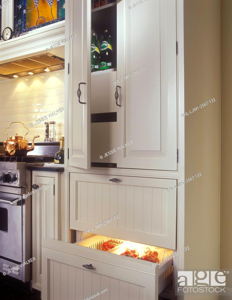 Stock Photo Kitchens Pantry On Top Of Sub Zero 700 Series Base Freezer Narrow Pullouts Either Side Range White And Stainless Steel Raised Panel