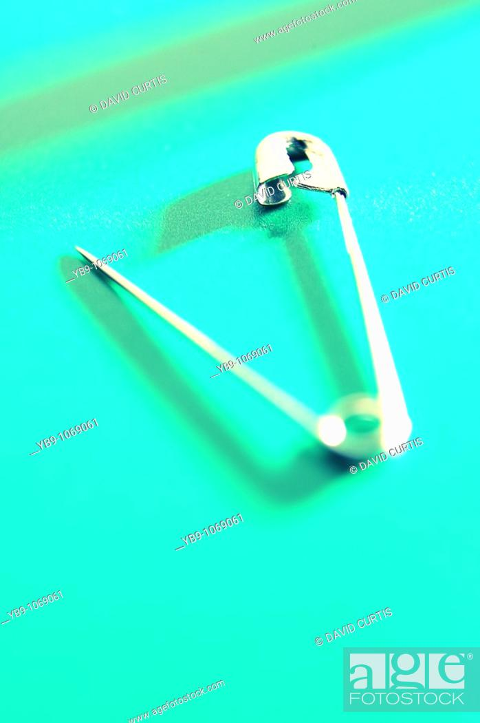 Stock Photo: Close up studio shot of a safety pin.