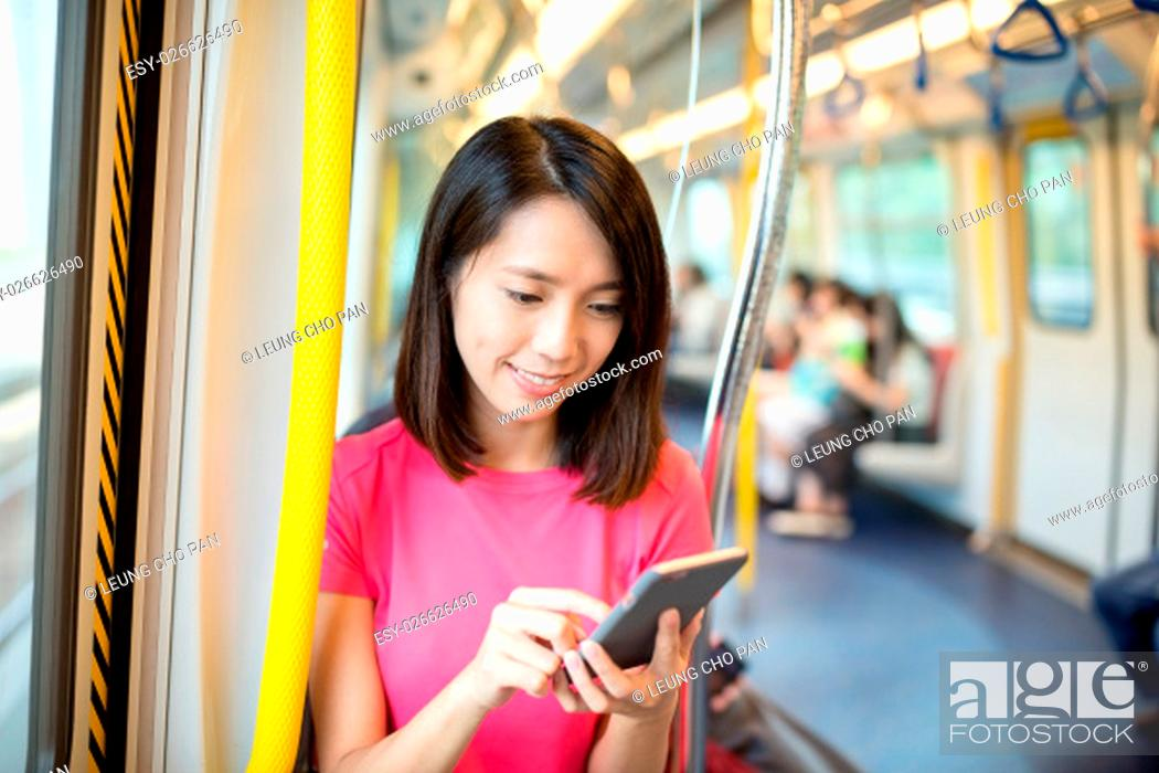 Stock Photo: Asian woman use of cellphone.