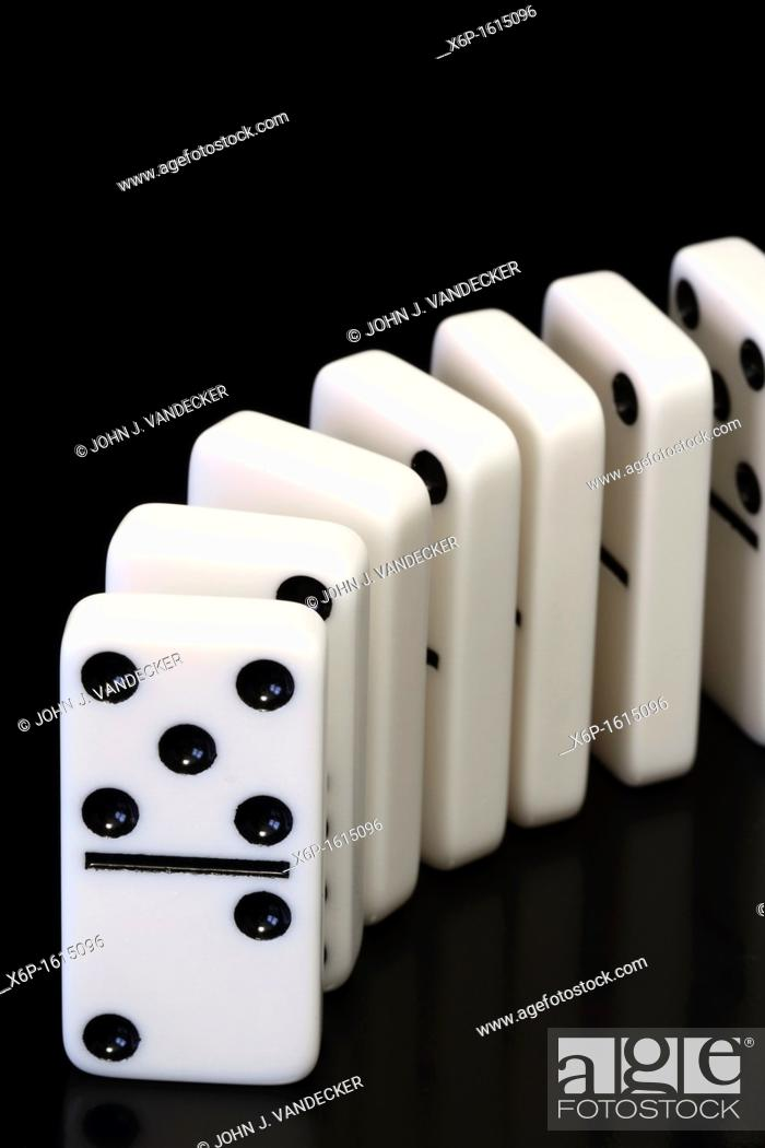 Stock Photo: Dominoes ready to topple.