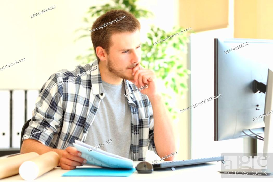 Stock Photo: Designer or architect working on line with a computer in a desktop at office.