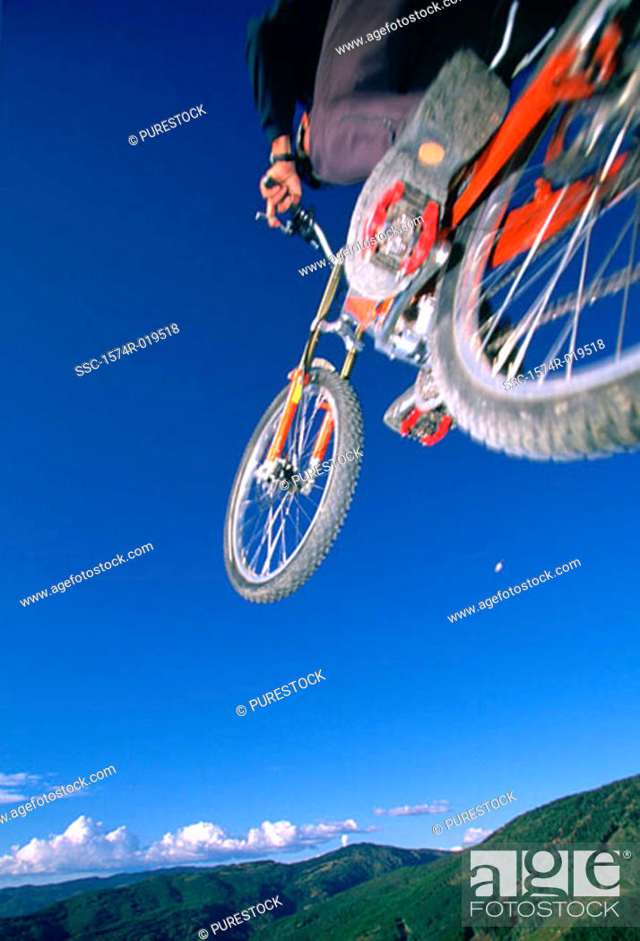 Stock Photo: Person performing stunt on mountain bike.