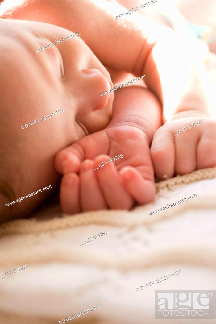 Stock Photo: New born baby sleeping in the sun.