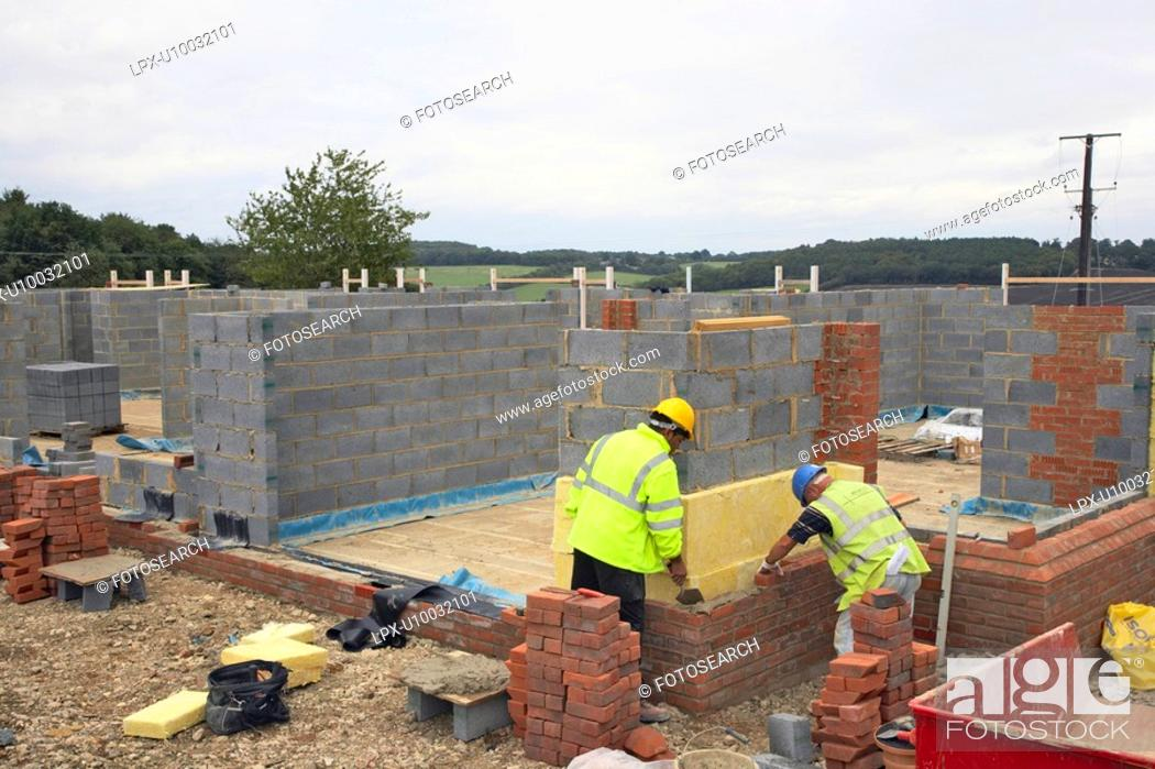 Stock Photo: Bricklayers on a house building site.