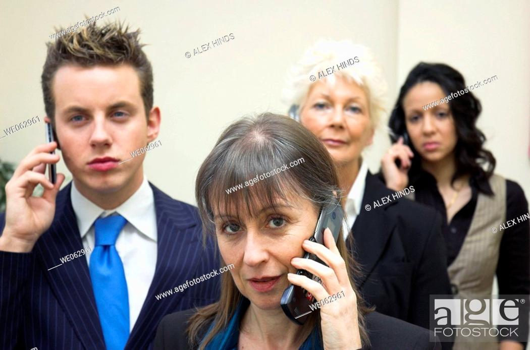 Stock Photo: Business team using mobile phones.