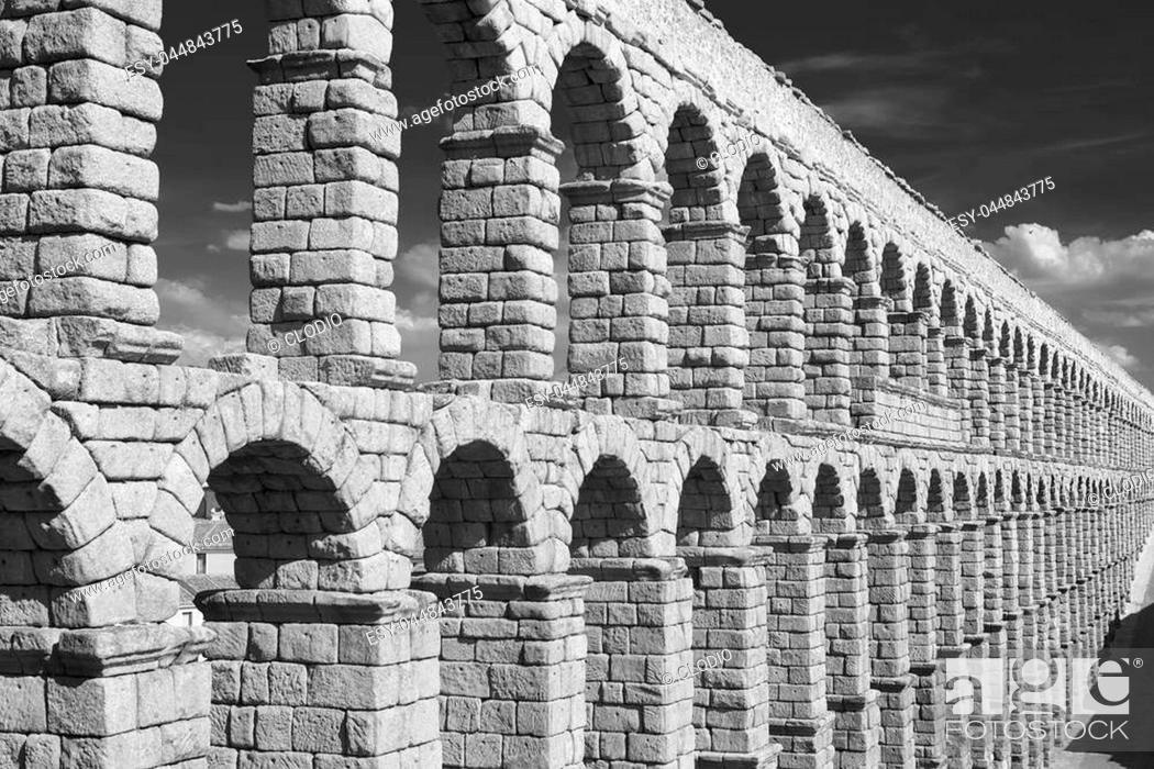 Stock Photo: Segovia (Castilla y Leon, Spain): the Roman aqueduct, Unesco World Heritage Site. Black and white.