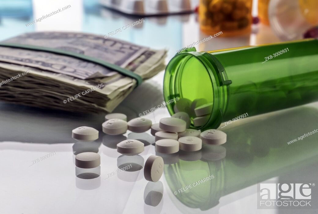 Stock Photo: Some medications on a ticket of dollar, conceptual image copay health.