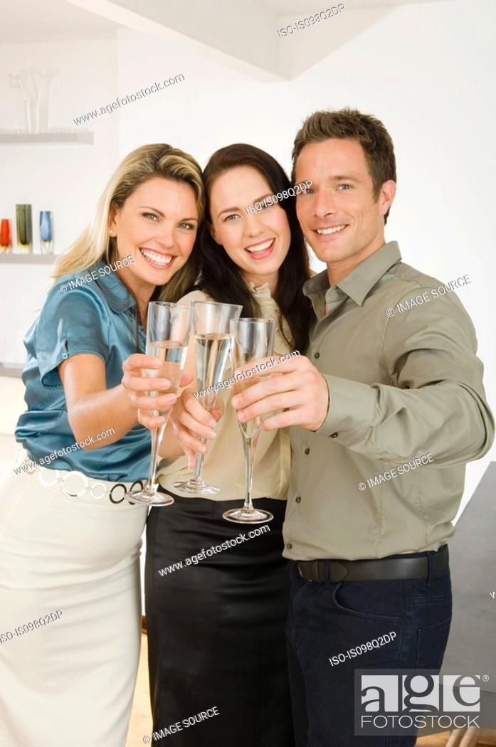 Stock Photo: Friends celebrating with champagne.