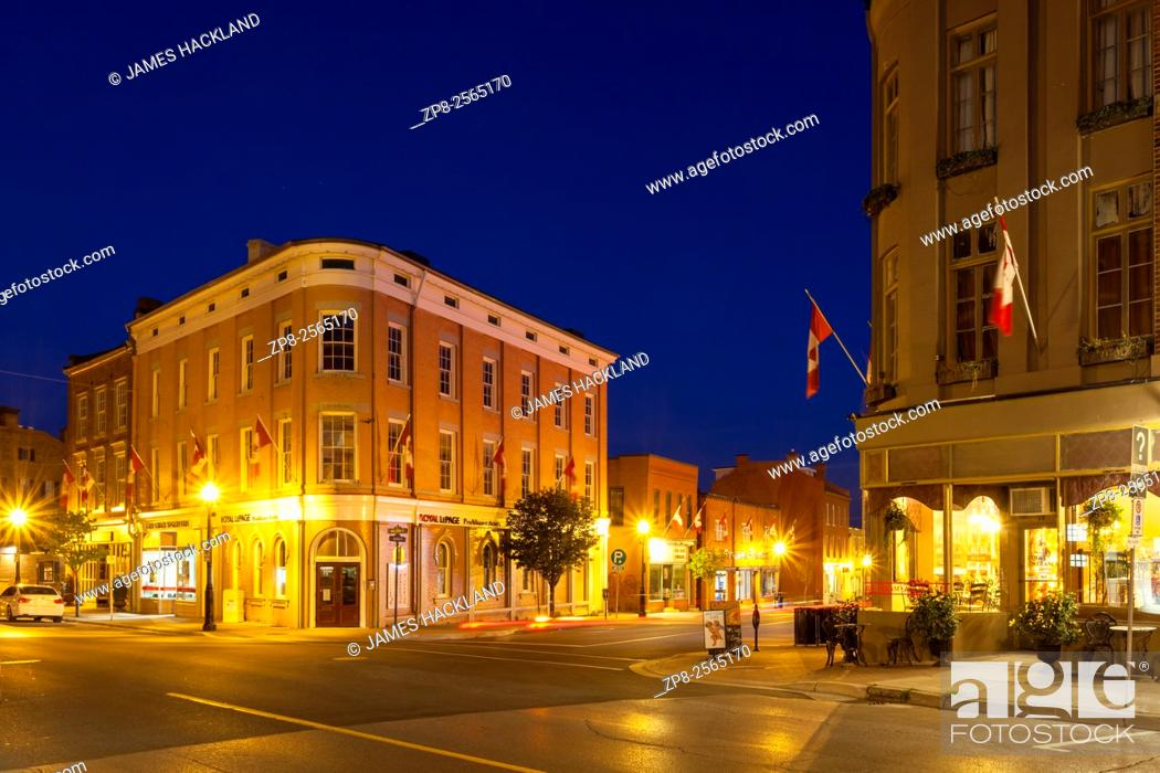 Stock Photo: Corner of Queen and Walton Streets in downtown Port Hope at dusk. Ontario, Canada.