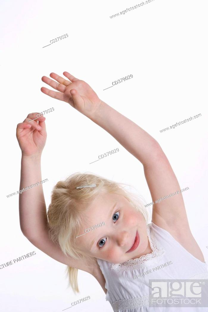 Stock Photo: Blond girl with her hands high.