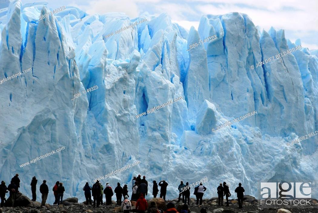 Stock Photo: Tourists on the glacier Perito Moreno Argentina.