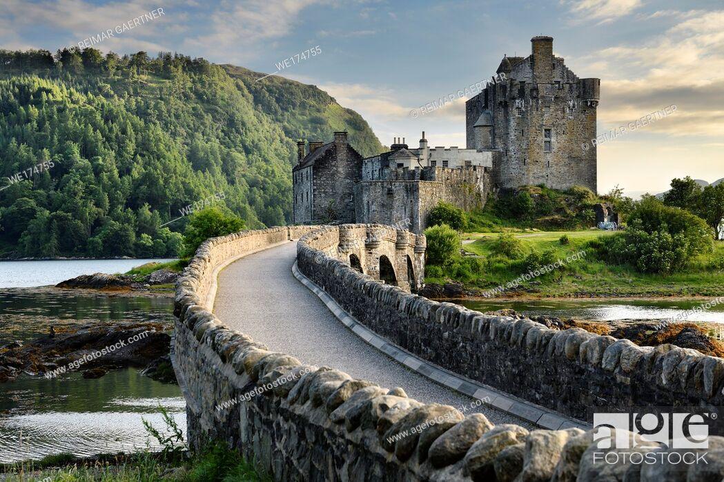 Stock Photo: Evening light on restored Eilean Donan Castle on Island at three lochs with added stone arch footbridge Scottish Highlands Scotland UK.