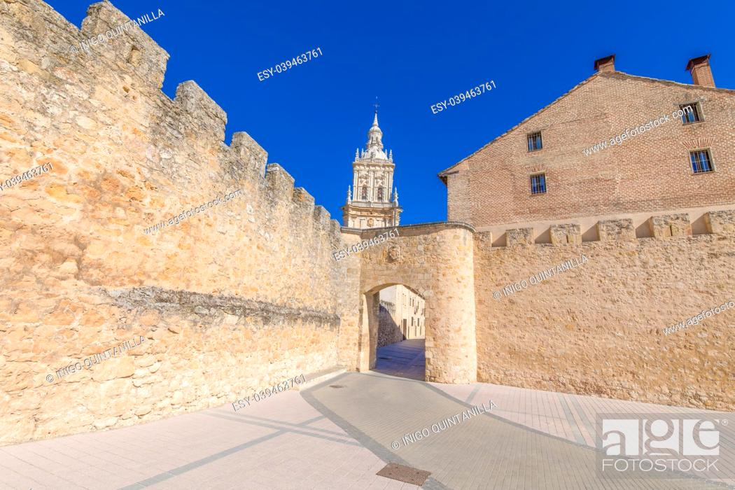 Stock Photo: main public access to Burgo de Osma medieval town, with public street and tower of cathedral, landmark and monument from thirteenth century, in Soria, Spain.