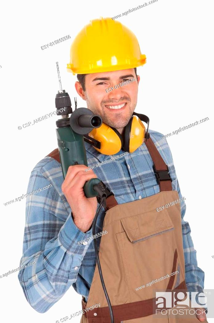 Stock Photo: Worker holding drill and wearing hard hat.