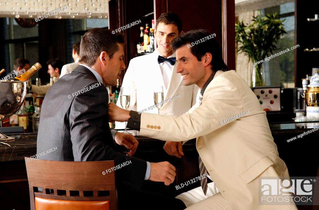 Stock Photo: Two men in agreement at a bar.