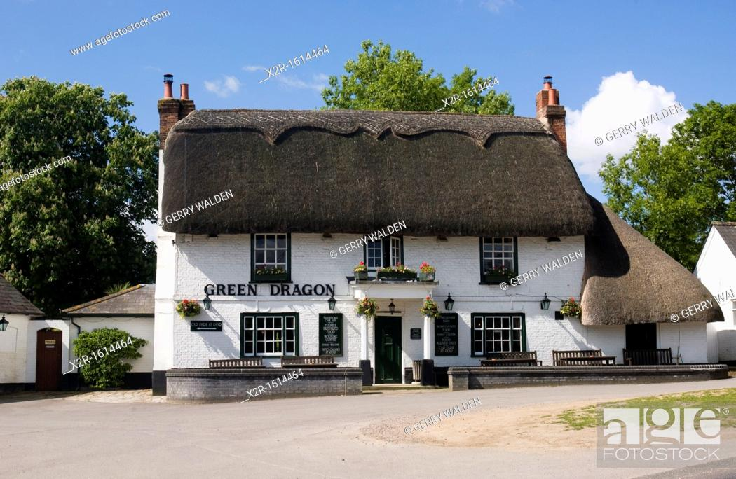 Stock Photo: 'The Green Dragon' public house inn at Brook in the New Forest National Park, Hampshire, England  The building is a traditional thatched building typical of the.
