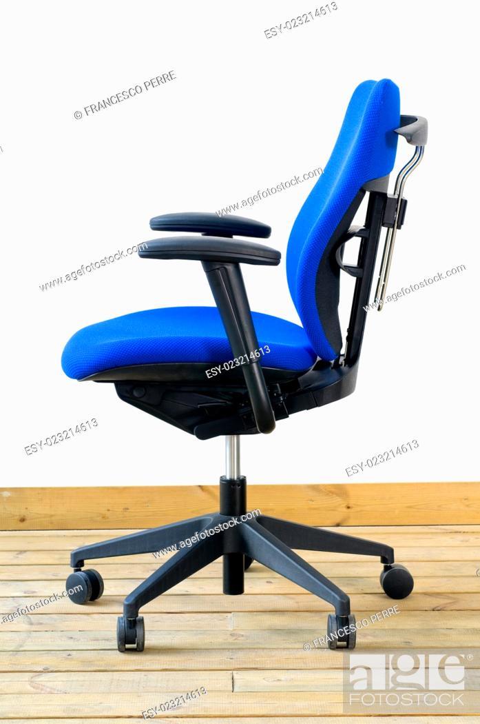 Imagen: modern blue office chair on wood floor over white background.