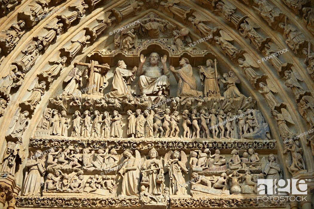 Stock Photo: Tympanum of central west portal: Christ in Majesty presides over the Day of Judgement, supported by an array of saints. Gothic Cathedral of Notre-Dame, Amiens.