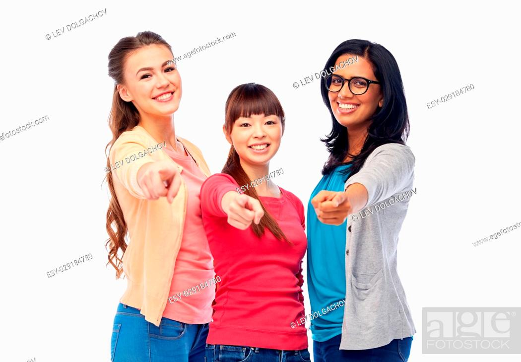 Stock Photo: diversity, race, ethnicity and people concept - international group of happy smiling different women over white pointing finger at you.